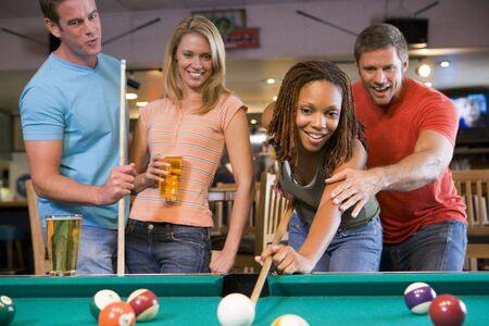 billiards cues: Friends playing pool Stock Photo