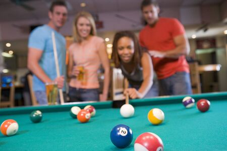 billiards tables: Friends playing pool Stock Photo