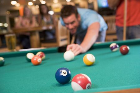 billiards tables: Man playing pool Stock Photo