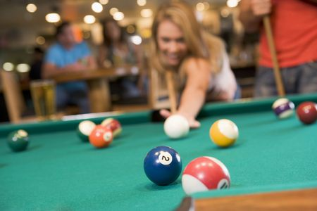 pool balls: Woman playing pool