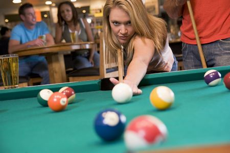 pool game: Woman playing pool