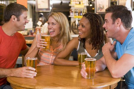 Two couples having beer together Stock Photo - 3206748