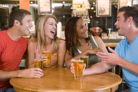 Two couples having beer together Stock Photo - 3206746