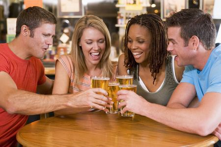 two couples: Two couples having beer together