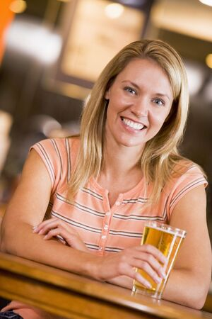 offset views: Woman having a glass of beer Stock Photo