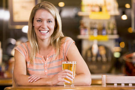 only one woman: Woman having a glass of beer Stock Photo