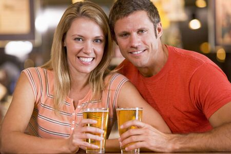 Couple having beer together photo