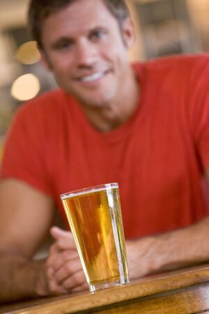 offset angles: Man having a glass of beer