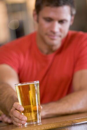 offset angle: Man having a glass of beer