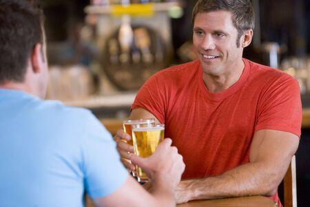 Two men having beer together photo