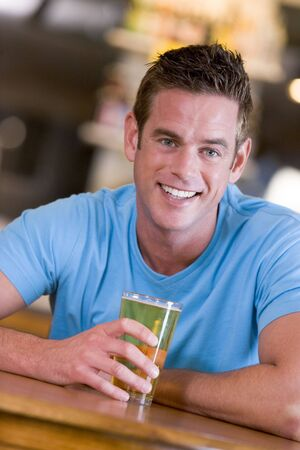 only mid adult men: Man having a glass of beer