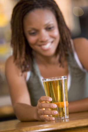 night club series: Woman having a glass of beer Stock Photo