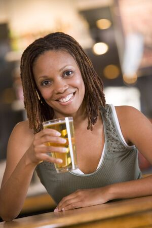 one mid adult woman only: Woman having a glass of beer Stock Photo