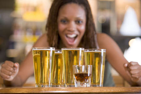 Woman posing with several beer glasses Stock Photo - 3207280