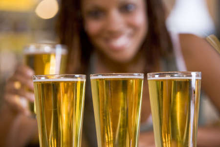 Woman posing with several beer glasses photo