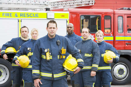 Six firefighters standing by fire engine Stock Photo - 3207572