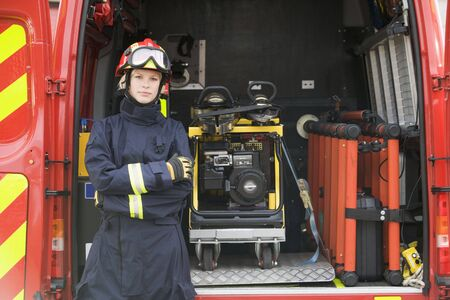 Rescue worker standing by open back door of rescue vehicle photo