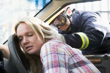 motorcars: Fireman helping a woman after she got in an accident Stock Photo