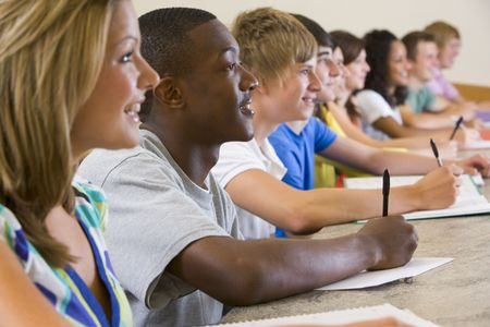 Students in class paying attention and taking notes (selective focus) Stock Photo - 3200838
