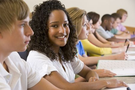 Students in class paying attention and taking notes (selective focus) photo