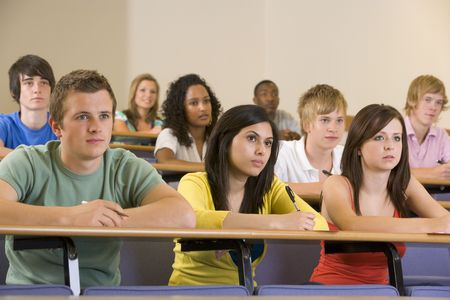 Students in class paying attention and taking notes (depth of field) Stock Photo - 3207644