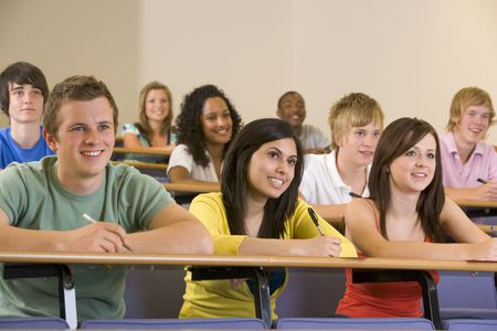 Students in class paying attention and taking notes (depth of field) photo
