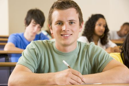 Student in class taking notes (selective focus) Stock Photo - 3201267