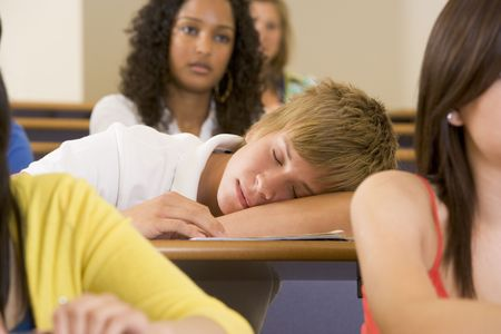dozing: Student in class sleeping (selective focus)