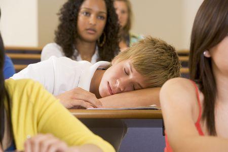 misbehaving: Student in class sleeping (selective focus)