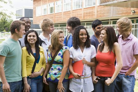 having fun: Group of students outdoors looking at camera smiling Stock Photo