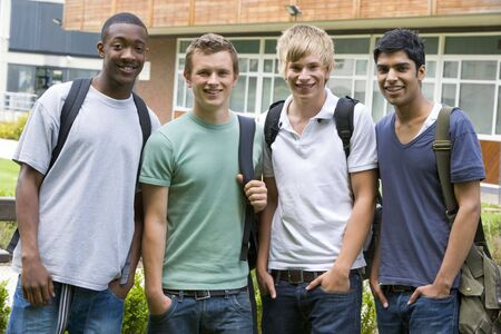 ruck sack: Group of students outdoors looking at camera smiling Stock Photo