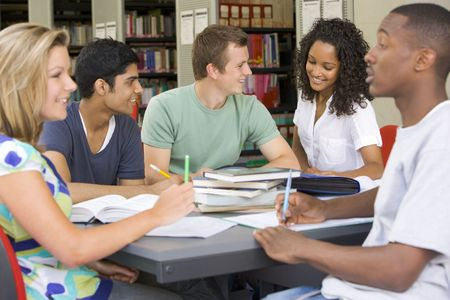 Five people in library studying (selective focus) Stock Photo - 3204981