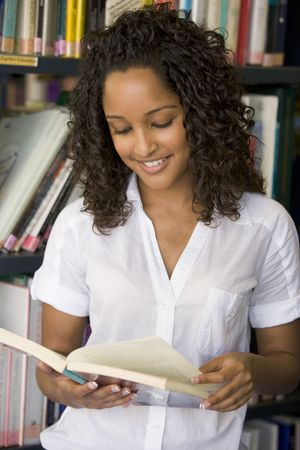 frontal views: Woman in library reading book