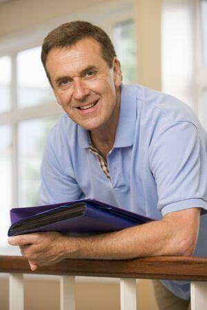 Teacher in corridor leaning on railing Stock Photo - 3177024