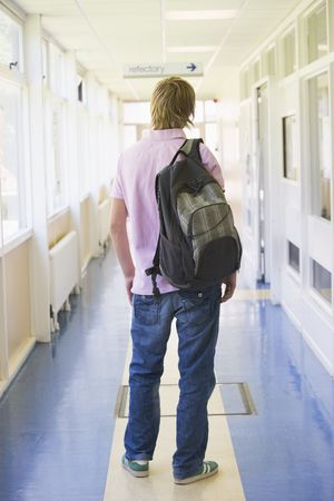 ruck sack: Student standing in corridor (selective focus) Stock Photo