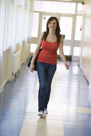 Student walking in corridor Stock Photo - 3199221