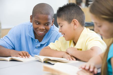 latin kids: Students in class reading together (selective focus)