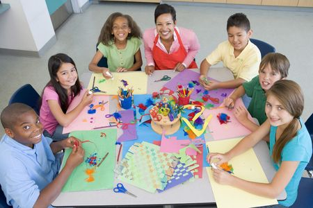 art and craft: Teacher and students in art class