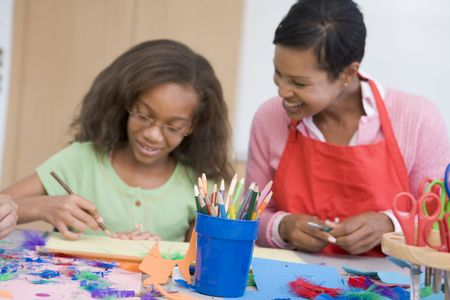 class rooms: Teacher and student in art class (selective focus)