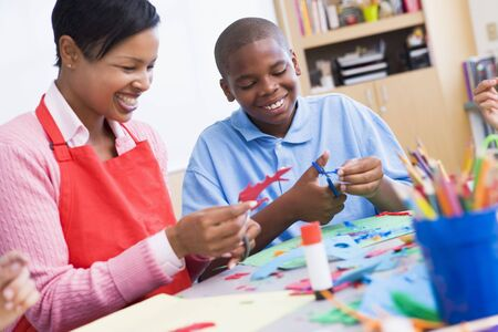 Teacher and student in art class (selective focus) Stock Photo