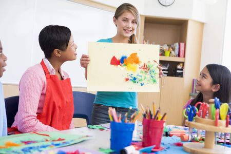 Student showing teacher and classmates her artwork (selective focus) Stock Photo