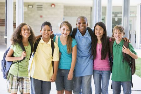 Six students standing outside school together smiling photo