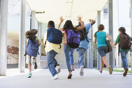 Six students running to front door of school excited photo