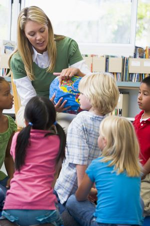 Teacher in class showing students a globe (selective focus) Stock Photo - 3205149