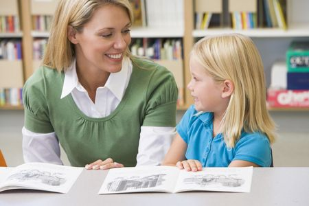 Student in class reading with teacher Stock Photo - 3205131