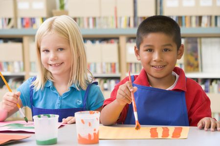 craft supplies: Two students in art class painting Stock Photo