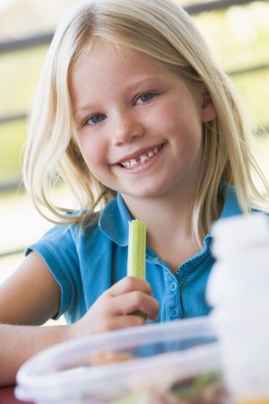 Student outdoors eating lunch (selective focus) Stock Photo - 3204988