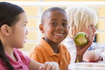 black children: Students outdoors eating lunch (selective focus)