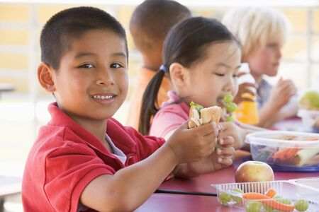 Students outdoors eating lunch (selective focus) photo