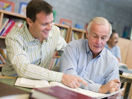 Two men in library talking (selective focus) photo